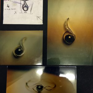Pendente e bracciale in oro bianco con brillanti e perla grigia realizzato a mano