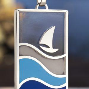 Pendente in argento, resina, contenente: acqua di mare di Napoli, sabbia ed altri materiali raccolti sulle sue spiagge. Lato A